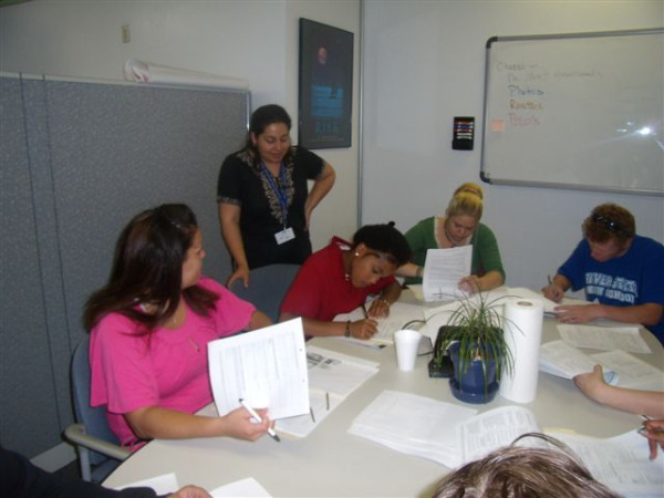 CSA - Interior meeting room with employees in discussion